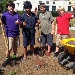 Jared, Thomas, Eli, & Luca proudly show off the Tuttle House artifact they found while digging out the final raised bed.