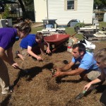 Jack, Erica, and Madi transplant seedlings into the florikan bed.