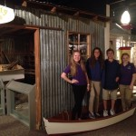 8th graders pose inside Fogarty's fishing boat